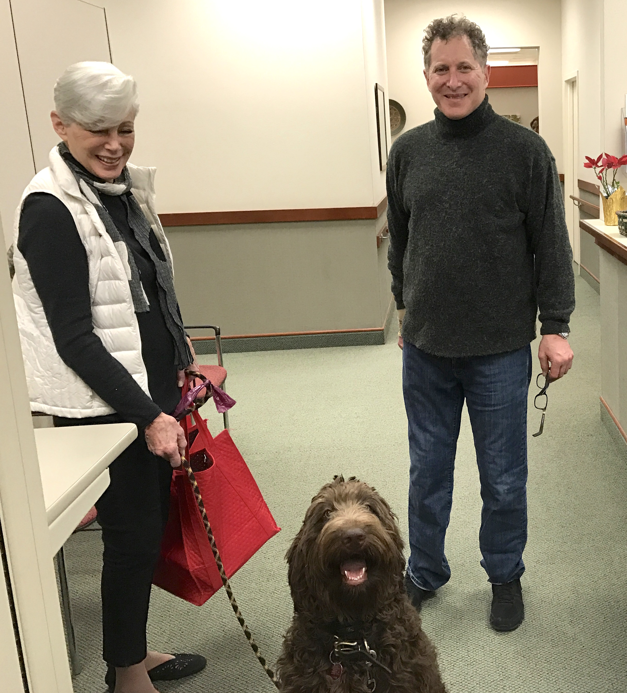 Dr. Andrew Rubin at Dankmeyer, with his mother and Luca the Goldendoodle.
