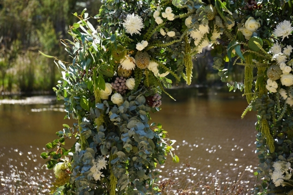 A sample of greenery garland for a wedding arch.  Contact   us  for exact styling and appearance.