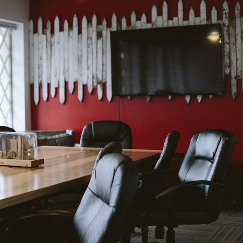 The Conference Room is suitable for meetings with up to 15 people. The rectangular table can fit up to 10 people around it with other seating in the room. Equipped with a large whiteboard, TV with Chromecast or HDMI connectivity (w/ dongle for Apple).
