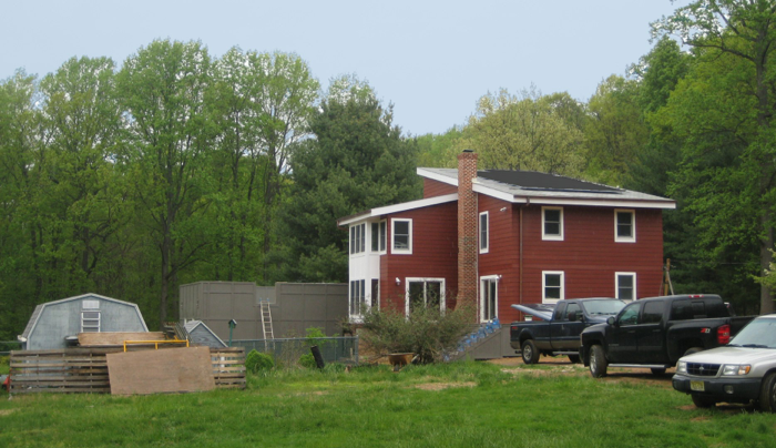 View from south west with solar electric and hot water panels.