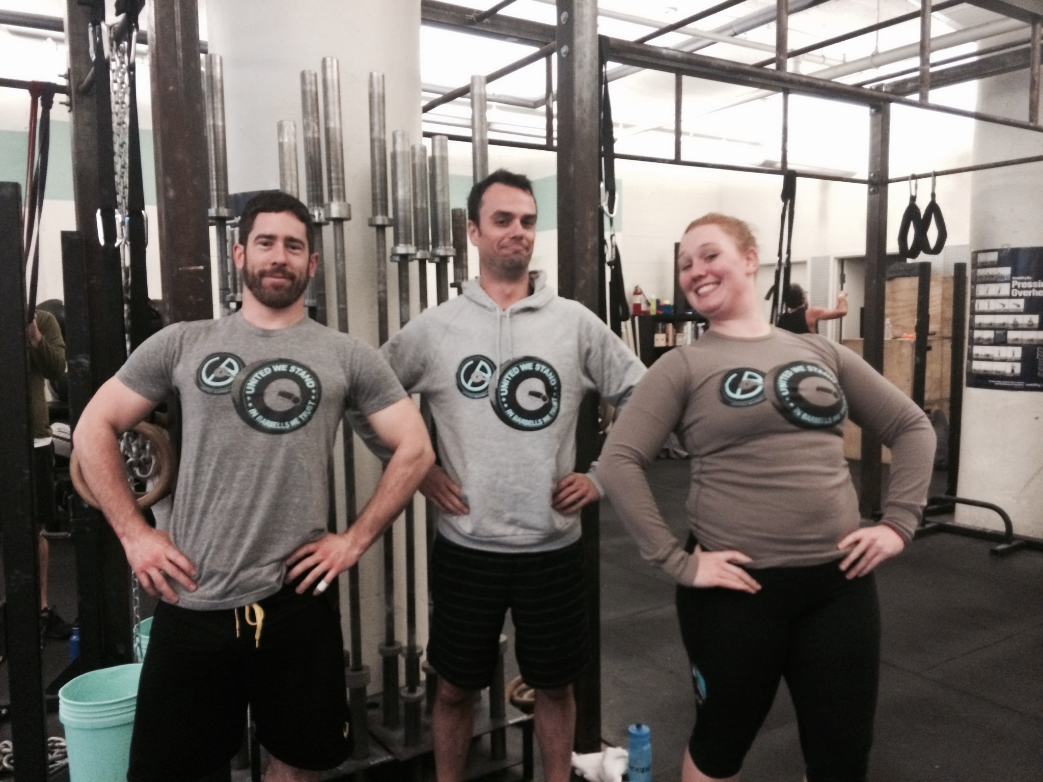Andrew, Tristan, and Megan showing off their ub tees