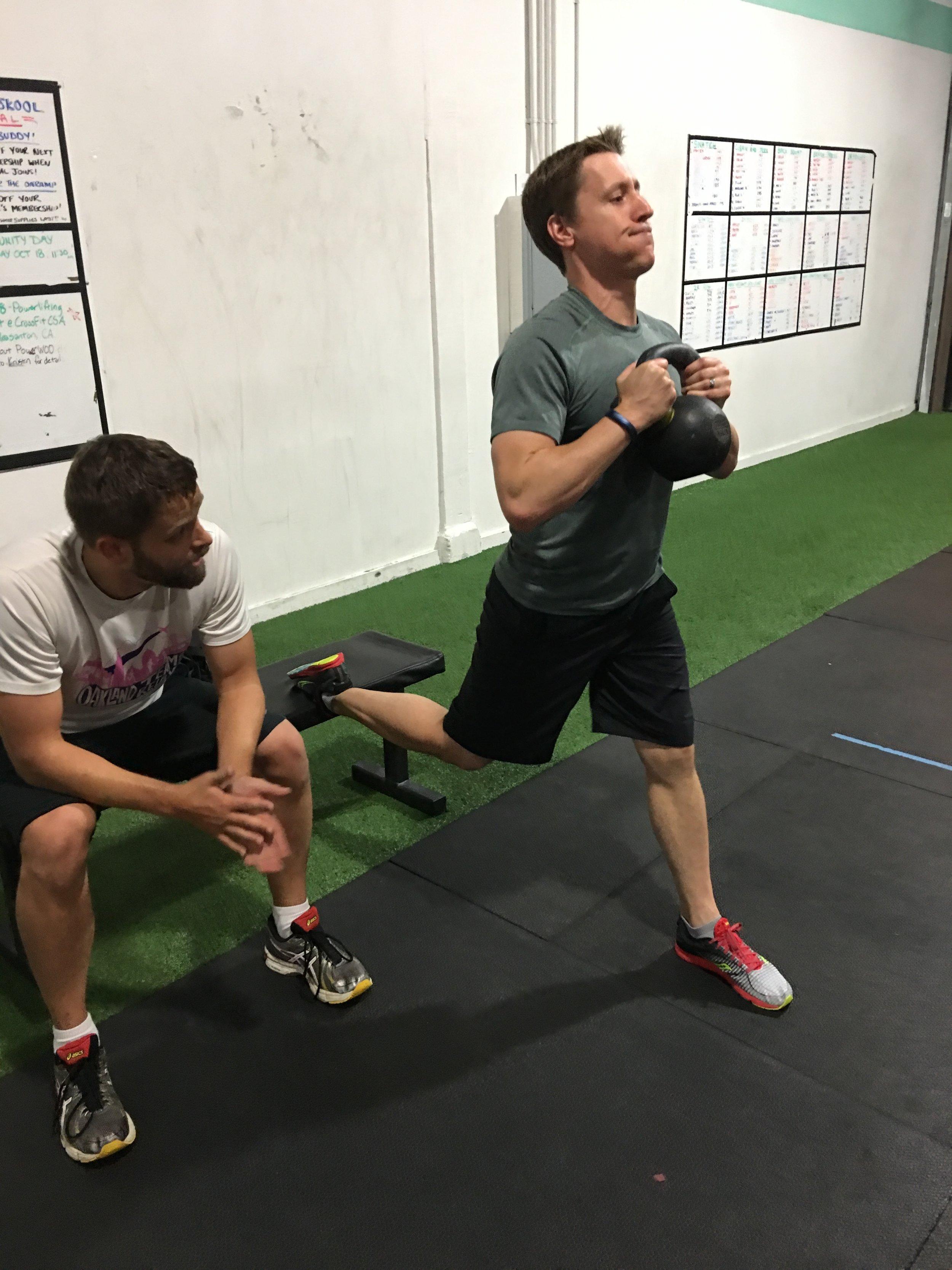 Kevin anchoring Jeremy's split squats