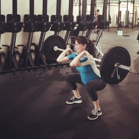 Squatting with weights while pregnant? Yes you can!