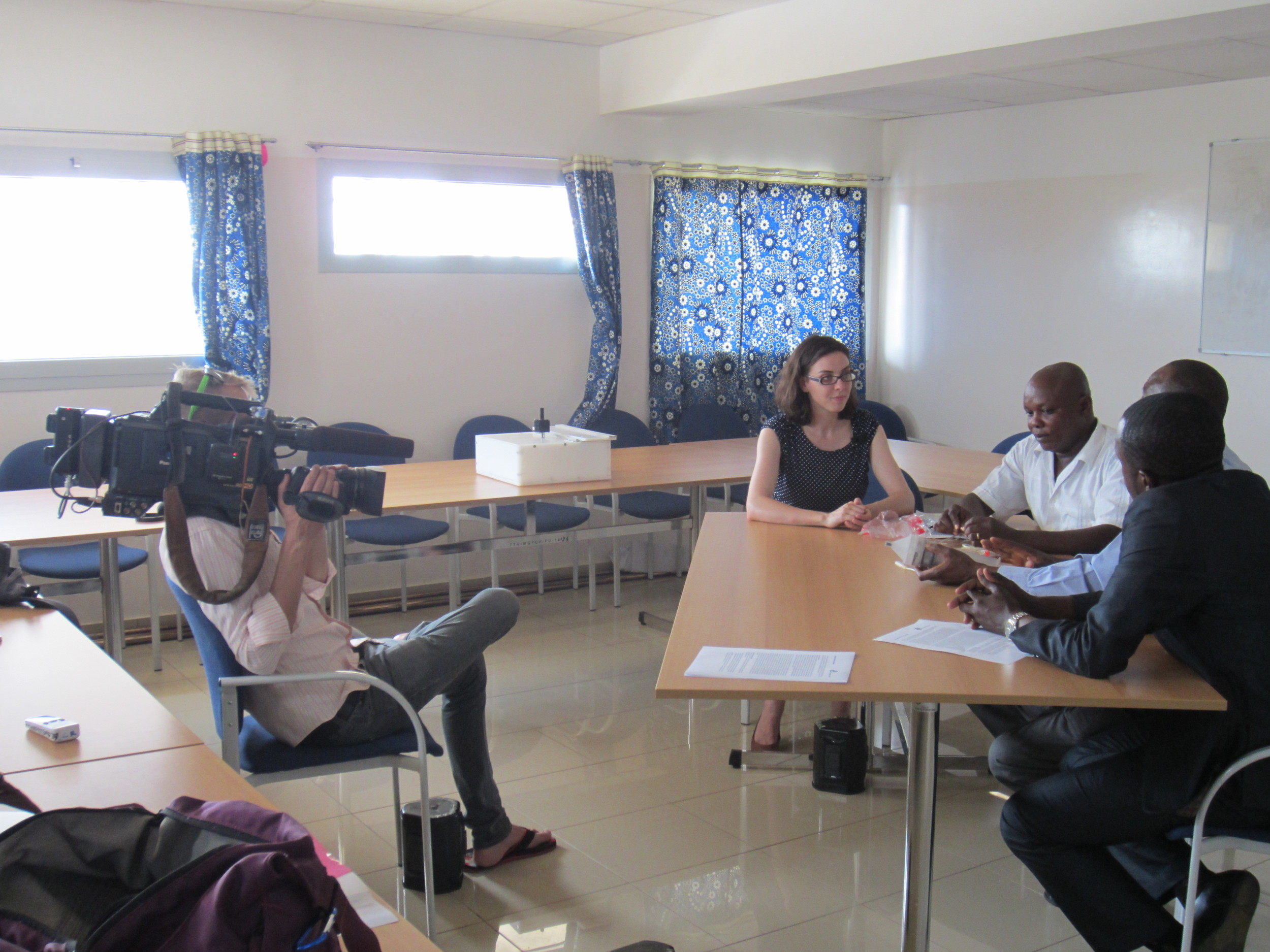 Timothy Wolfer (behind camera) filming Gillian Henker; Dr. Peter Paul Bacheyie, Head of Blood Transfusions; Dr. David Kolbila, Head of OBGYN; and Dr. Asirifi Amoako Samuel, OBGYN consultant, at Tamale Teaching Hospital.