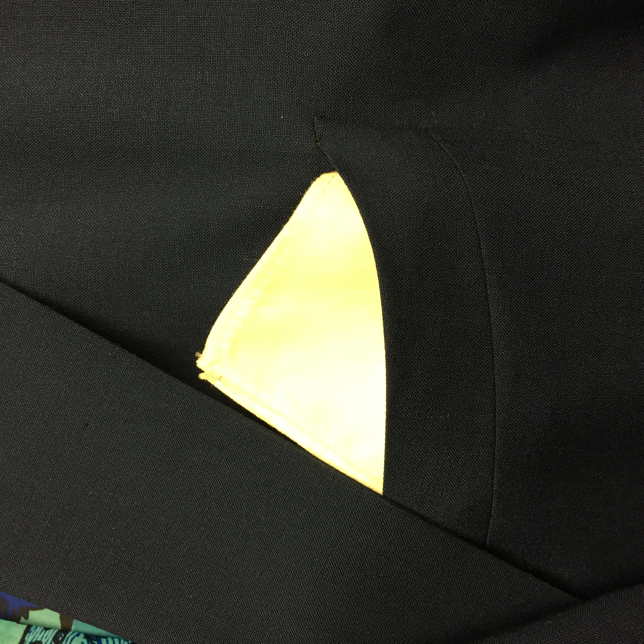 """Here the pocket square is folded into a square, and the four points are together. Just makes more a crisp """"blocking"""" effect."""