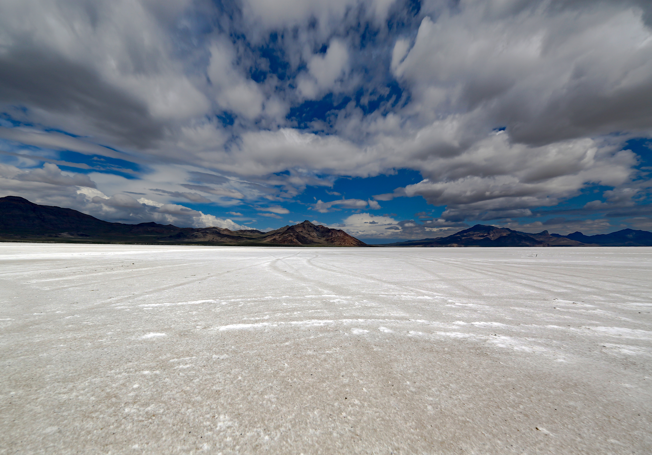 The salt flats are surrounded by unpopulated mountains rife with caverns and canyons for the adventurous traveler. It is not good to hike here by yourself or at night as this remote outpost is surrounded by rough terrain.