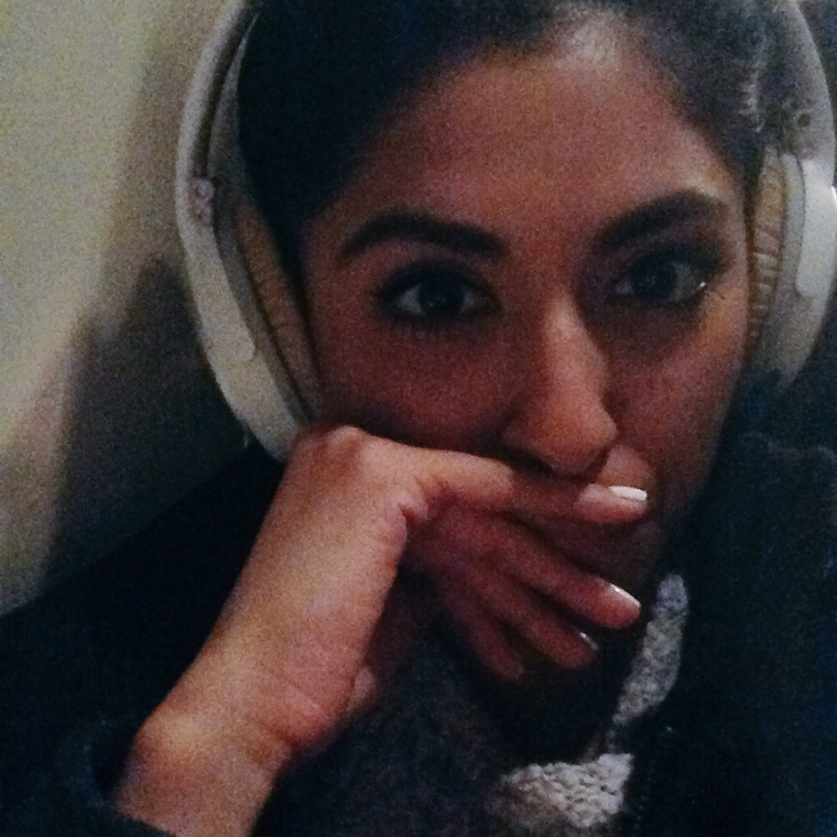 Tired eyes and grainy selfies after a long day of flying.