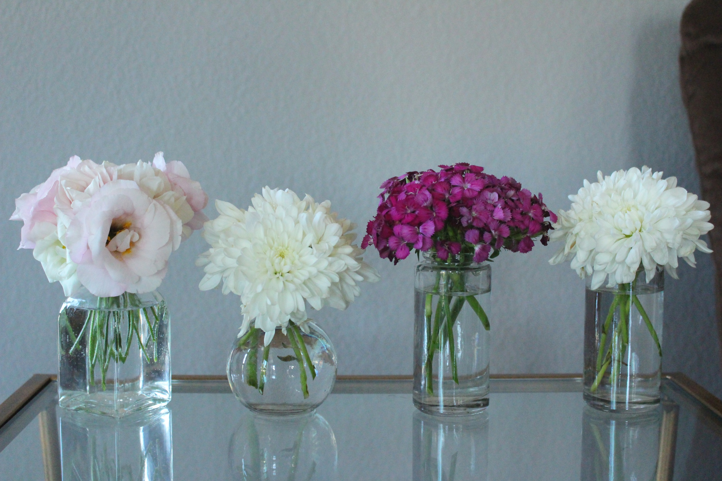 Blush tones and bud vases to brighten up the place.
