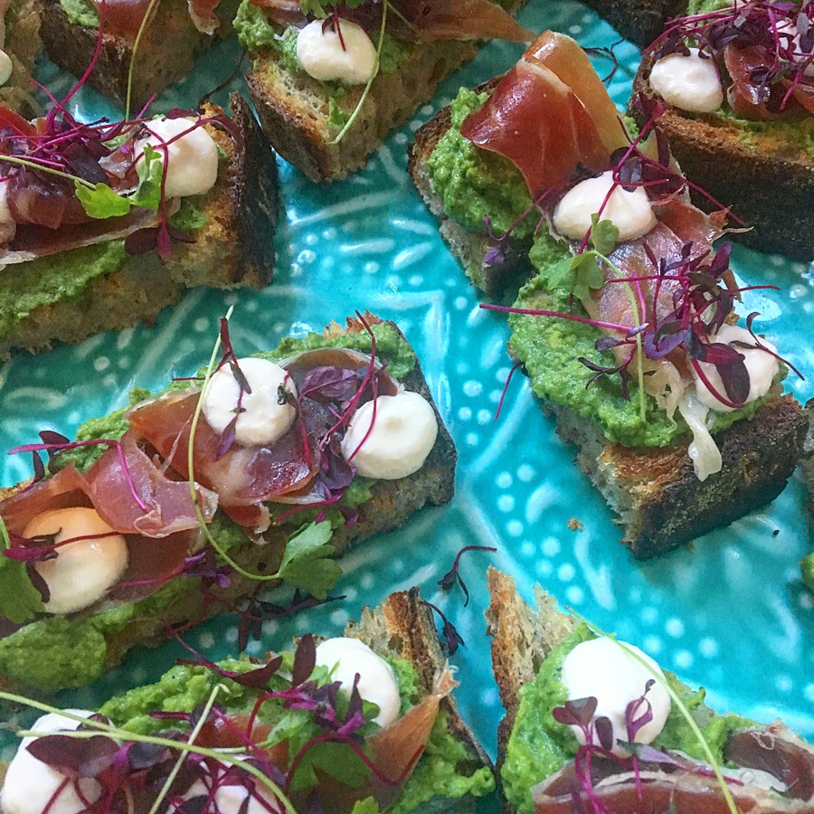 Toasted sourdough with minted peas, prosciutto, whipped feta, preserved lemon
