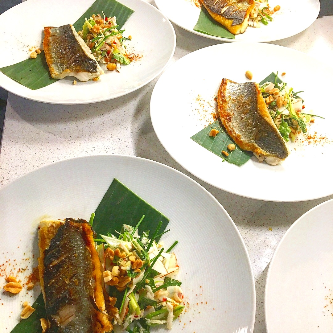 Tamarind glazed sea bass with fresh coconut, chilli, ginger and peanut salad with yuzu, mirin and palm sugar dressing.