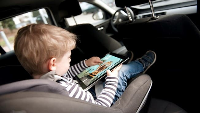 A kid playing a tablet