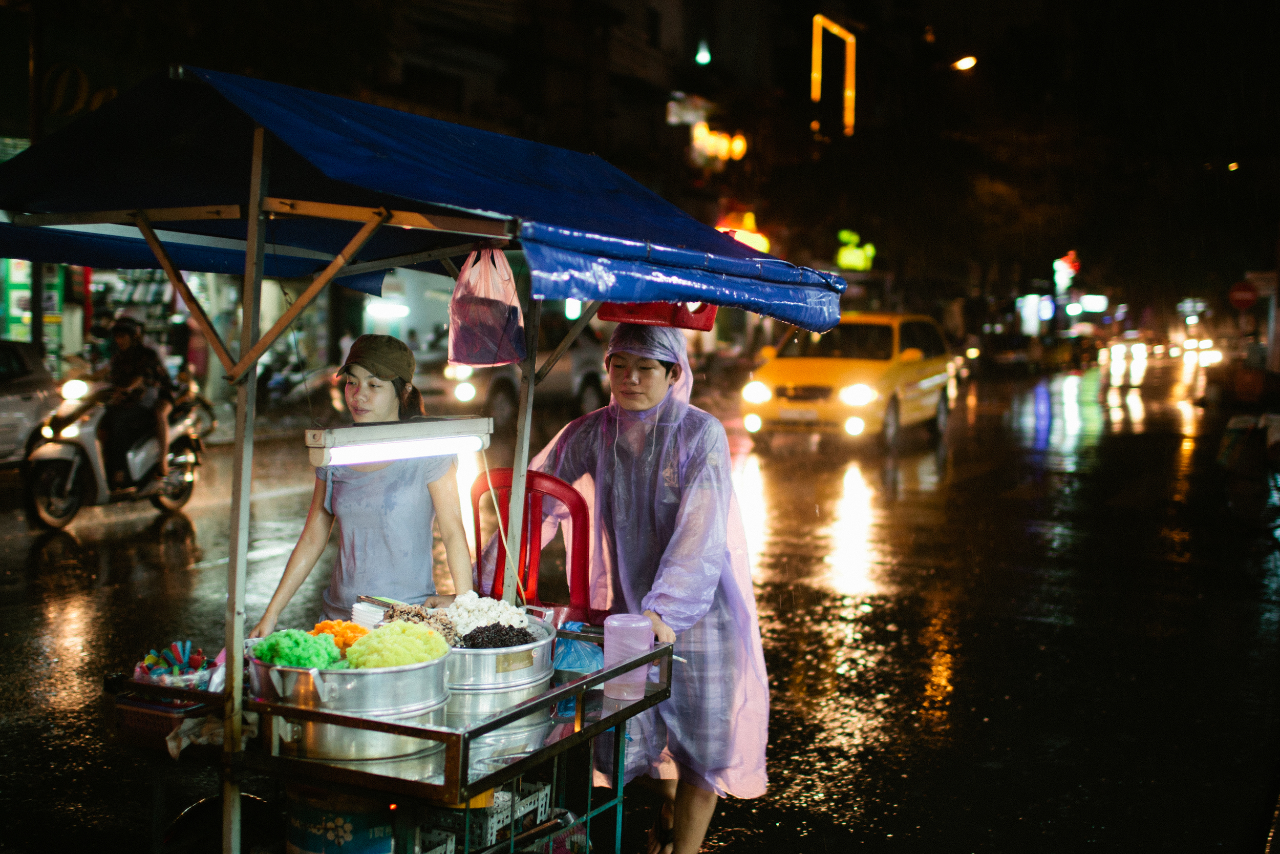 Out at a market in HCMC/Saigon one day when it started to rain.  Shot in 2011 with a Canon 1D3 and 35L.