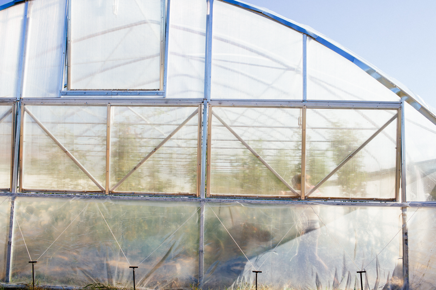 A worker at Doublebrook Farms maintaining a part of the moving greenhouse.