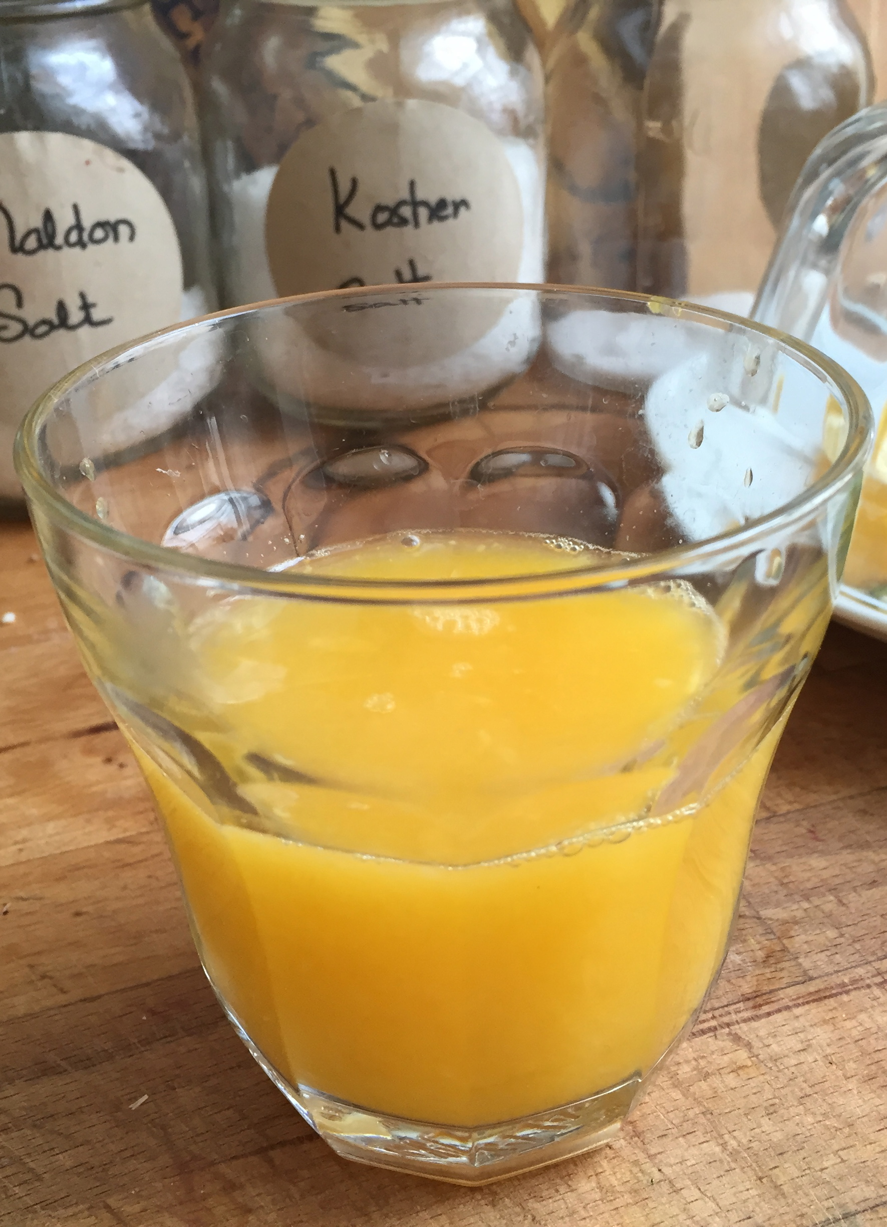 Is this enough orange juice? Usually I have a full cup, but the oranges I squeezed only yielded this much. I look at it for a long time and decide it is just exactly the right amount. Peaceful.