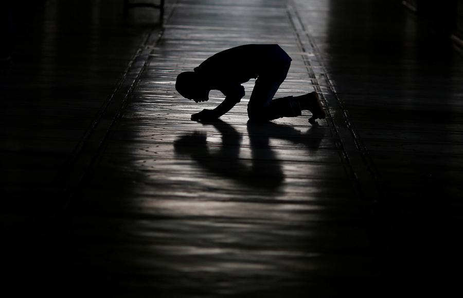 siloette of man praying.jpg