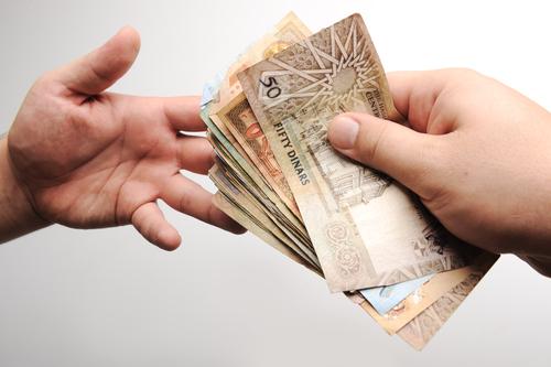 zakat-charity-money-Jordanian-dinar-shutterstock_82427101.jpg