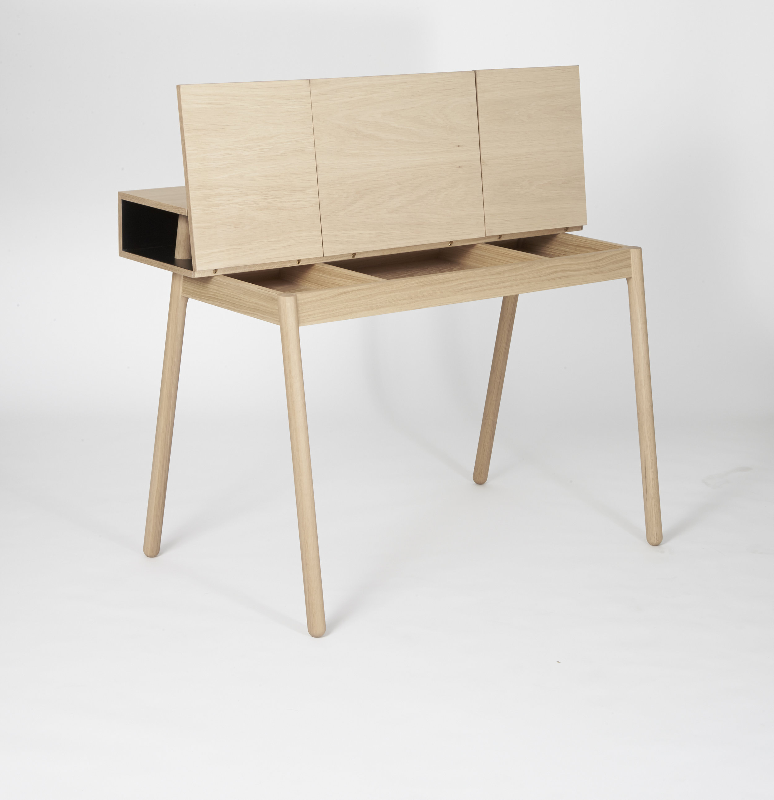 The desk is constructed using a sticks and plates technique, where the sticks support the top shelf. The legs prevent the top shelf from bending and provide an aesthetically pleasing look. -