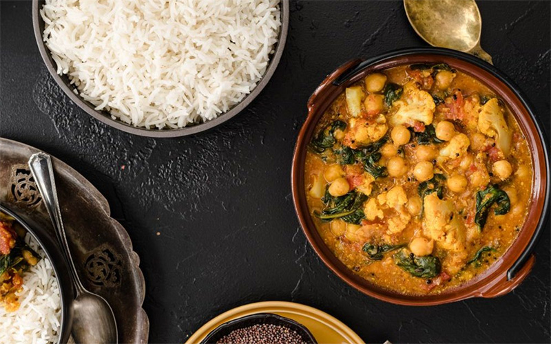 Chickpea Stew with Cauliflower and Spinach in a Mustard Sauce.  Recipe courtesy of spreadthemustard.com