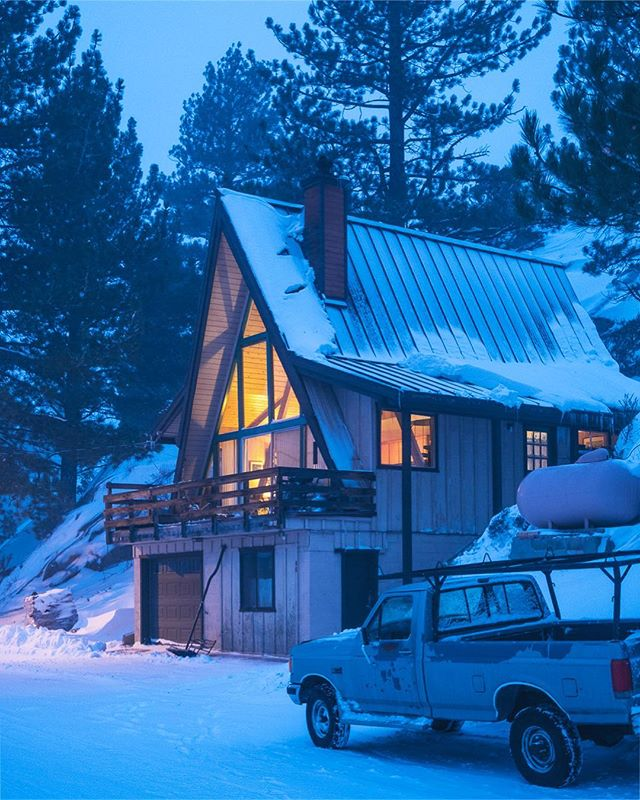 A warm looking A-frame found during an evening blizzard stroll.