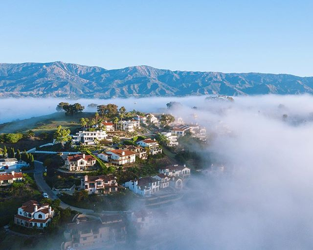 An emerald hilltop embraced by morning inversion layer in one of my favorite neighborhoods.