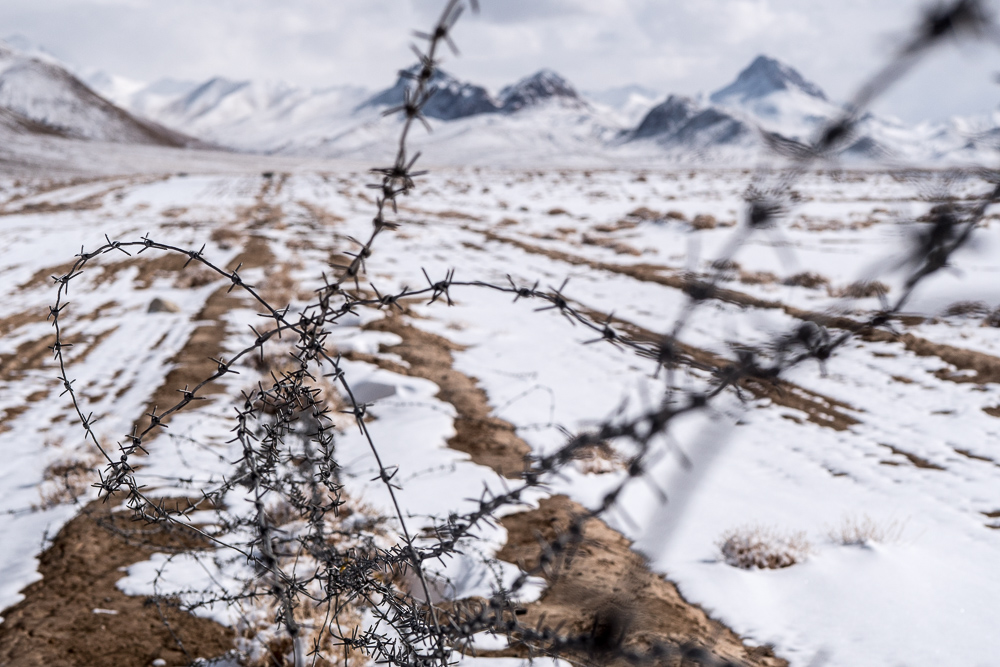 Barbed-wire fence snaking along the border between Tajikistan and China. Makes it tough for Marco Polo sheep to migrate. Photo credit:  Kate Harris .