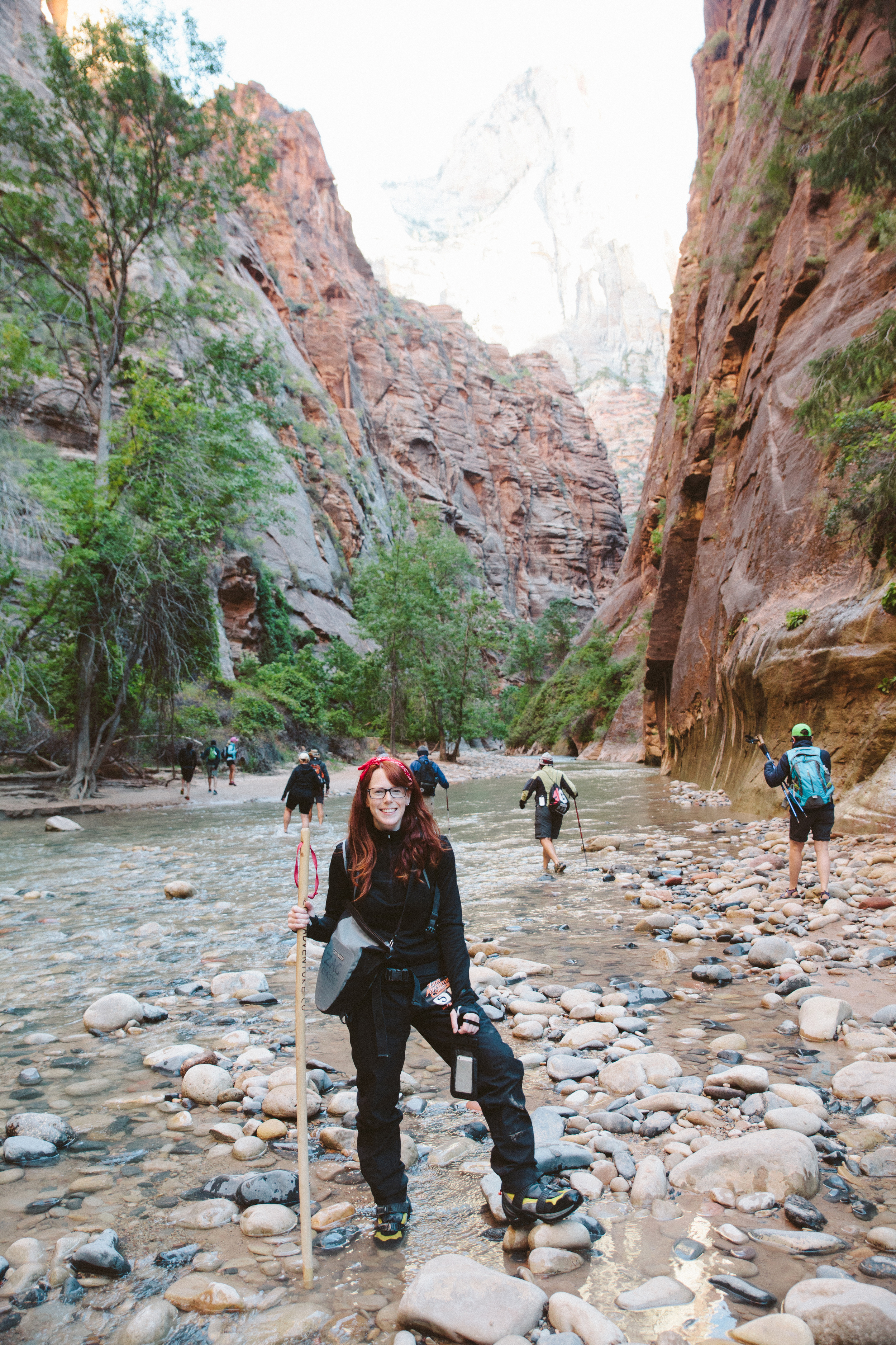 Hiking The Narrows in Zion National Park, UT in 2014.  The grey water-tight camera bag holds my Canon 5D Mark ii with Tamron 24-70mm f/2.8 lens.  Thank goodness for that bag because the water height was over my head a few times during the hike and the bag was submerged!