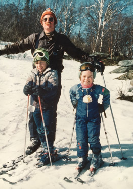 My father, brother, and me skiing.
