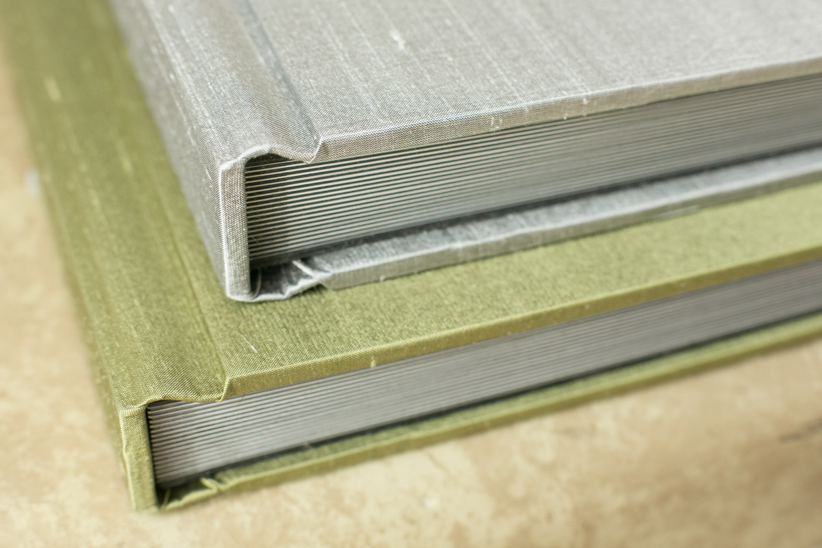 My albums are handmade by a classically trained traditional bookbinder. They come in a variety of colors in silk, linen, or velvet fabrics and are truly heirloom quality.