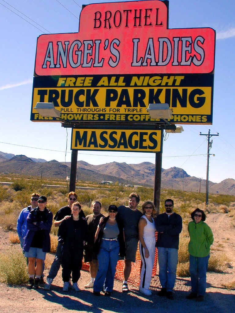 Posing in front of Angel's Ladies brothel sign.