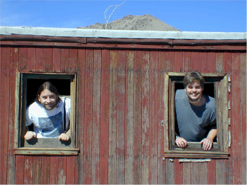 Exploring the inside of the caboose, Jonathan and Mike stick their heads out and say hi.