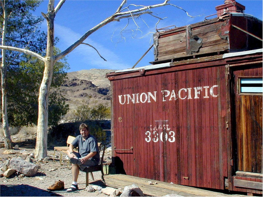 A Union Pacific caboose. Mike changes into hiking shoes.