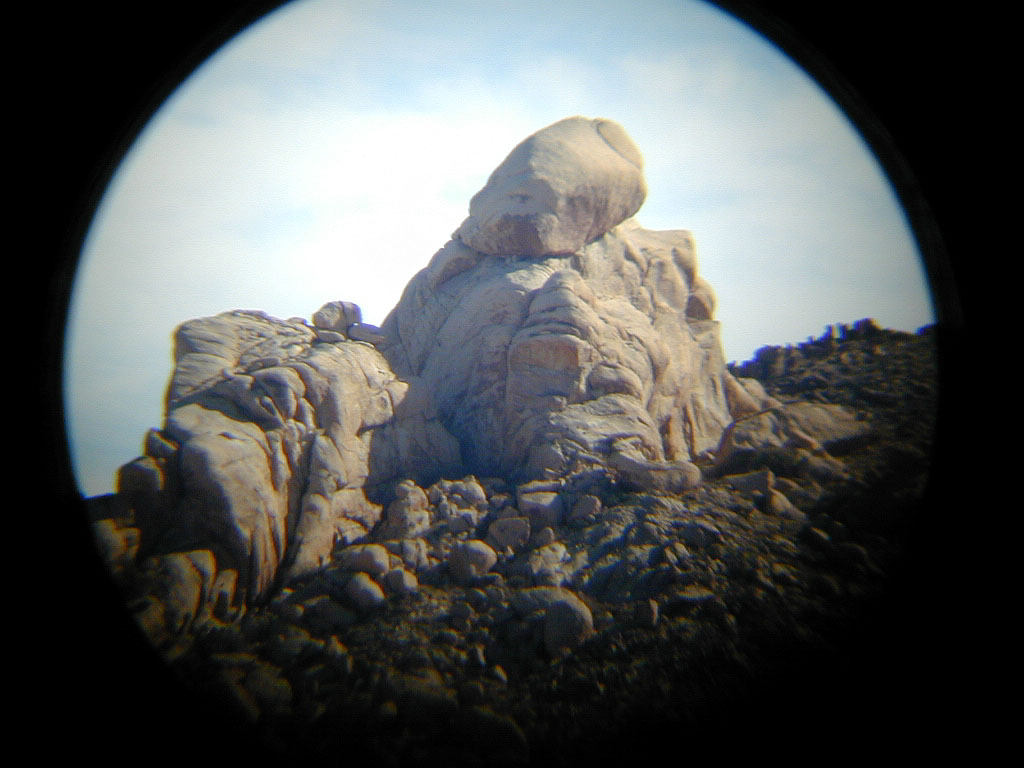 """Telephoto view of one of the """"knobs"""" near Knob Hill. You can see this (tiny) knob in the picture on the left."""