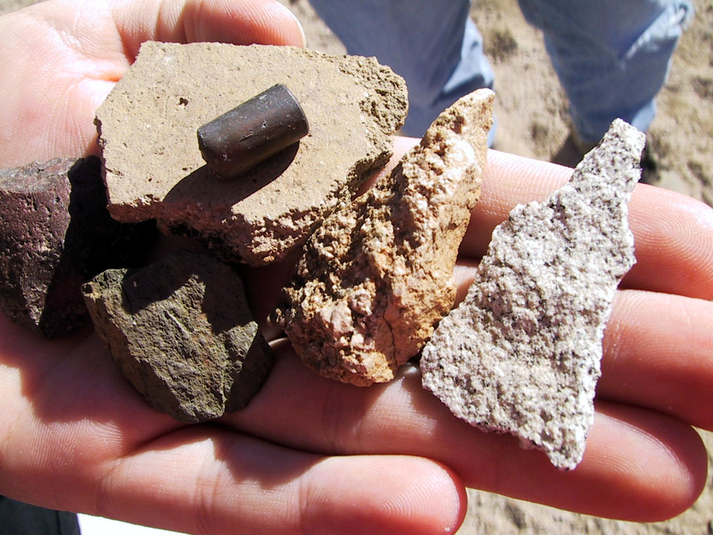This is what was found. The fragment of pottery (upper left) was the only thing worthwhile. The other items are a bullet and some rock fragments that vaguely resemble arrowheads.