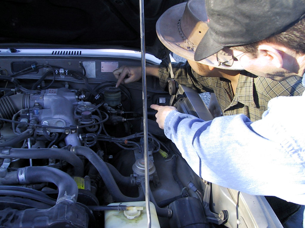 Hey, wait a minute Ted. The brake fluid is really over here, by the master brake cylinder.