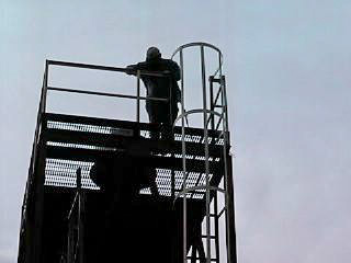 Chuck is atop the tower.