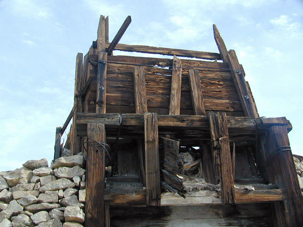 An ore chute positioned to dump ore into a mine cart. The tracks ran just below this chute