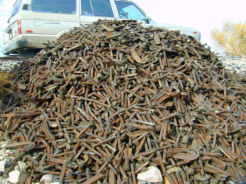 A cairn of railroad spikes.