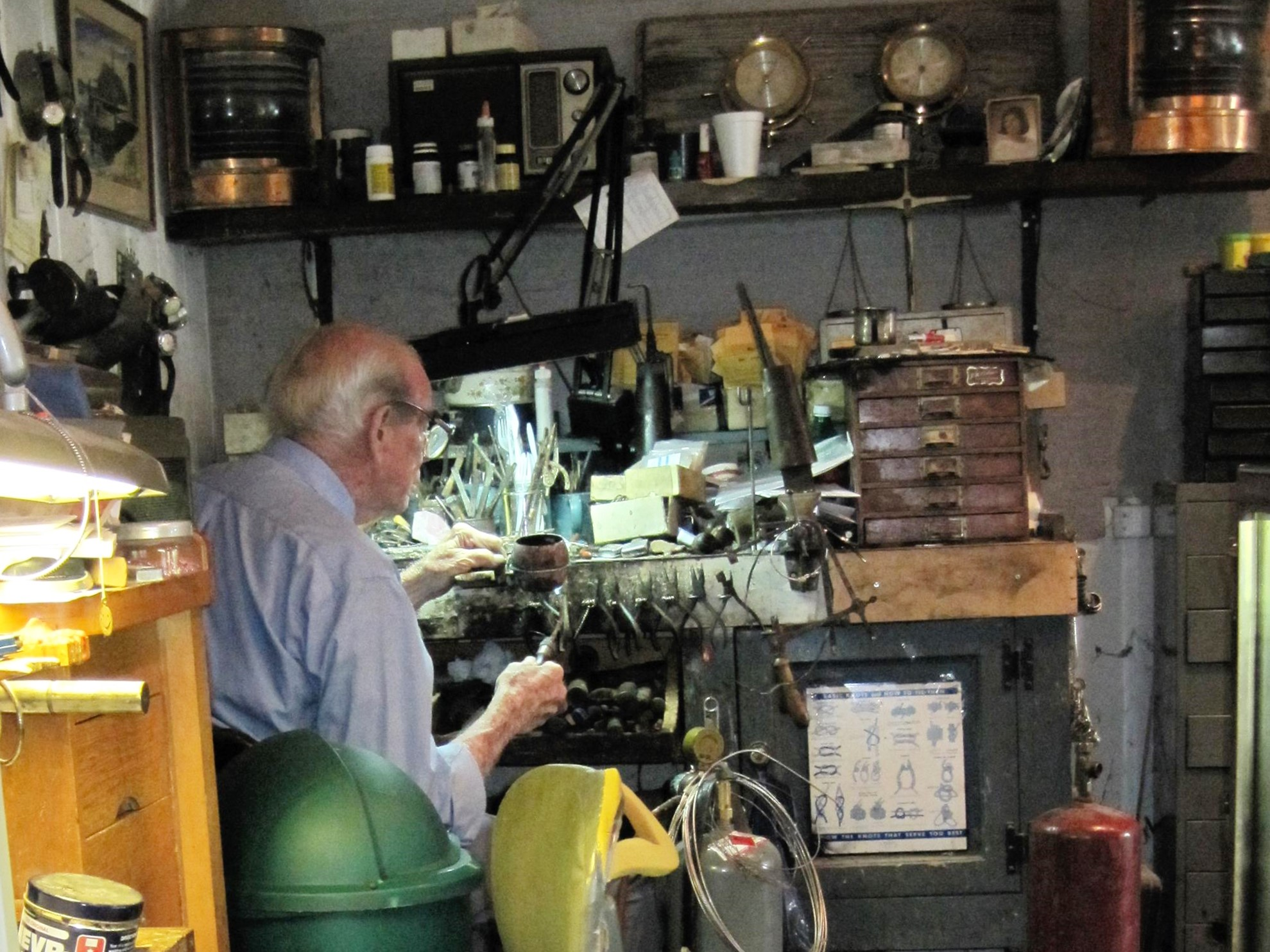 Dad at his bench in the store in July 2009