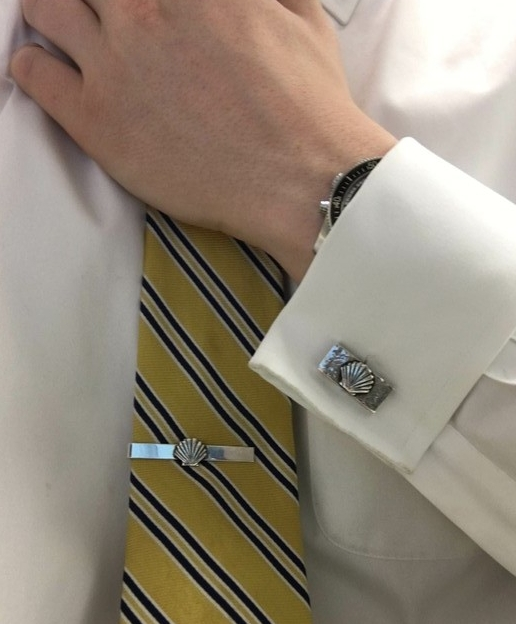 Dad's handmade sterling silver scallop shell tie clip was one of the rare pieces Dad made for himself.  The scallop shell cufflinks were made for his youngest grandson, Ted, who now wears both and models them here.