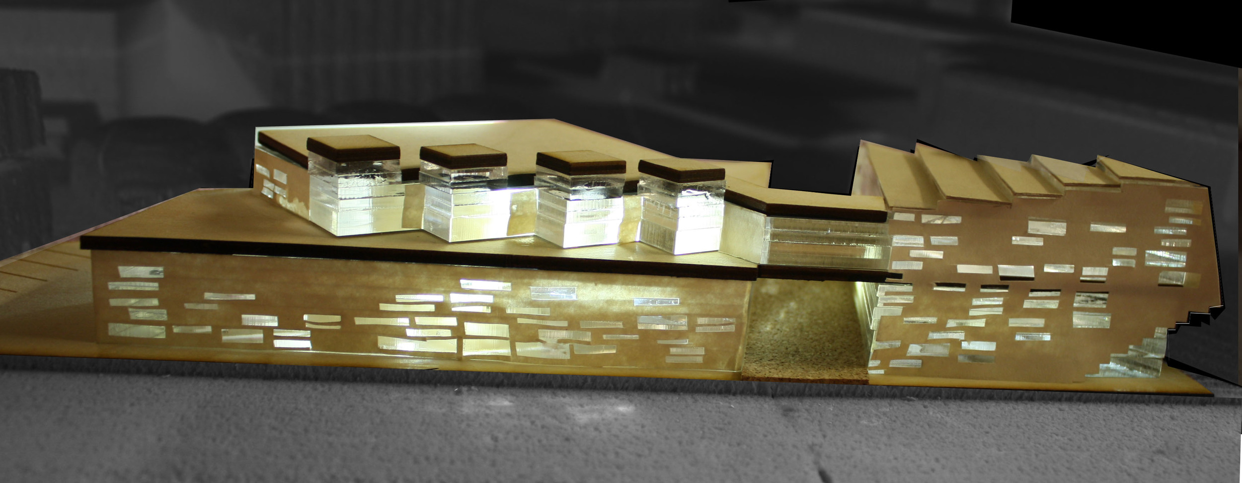 Model view of Eastern elevation. Illuminated study rooms on the second level are inspired by lanterns. They are beacons visible from the adjacent elevated subway platform.