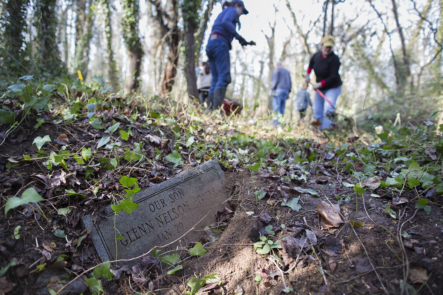 Grave of Glenn Nelson Jones, a young boy, revealed during East End Cemetery work day, January 2015. ©brianpalmer.photos 2015