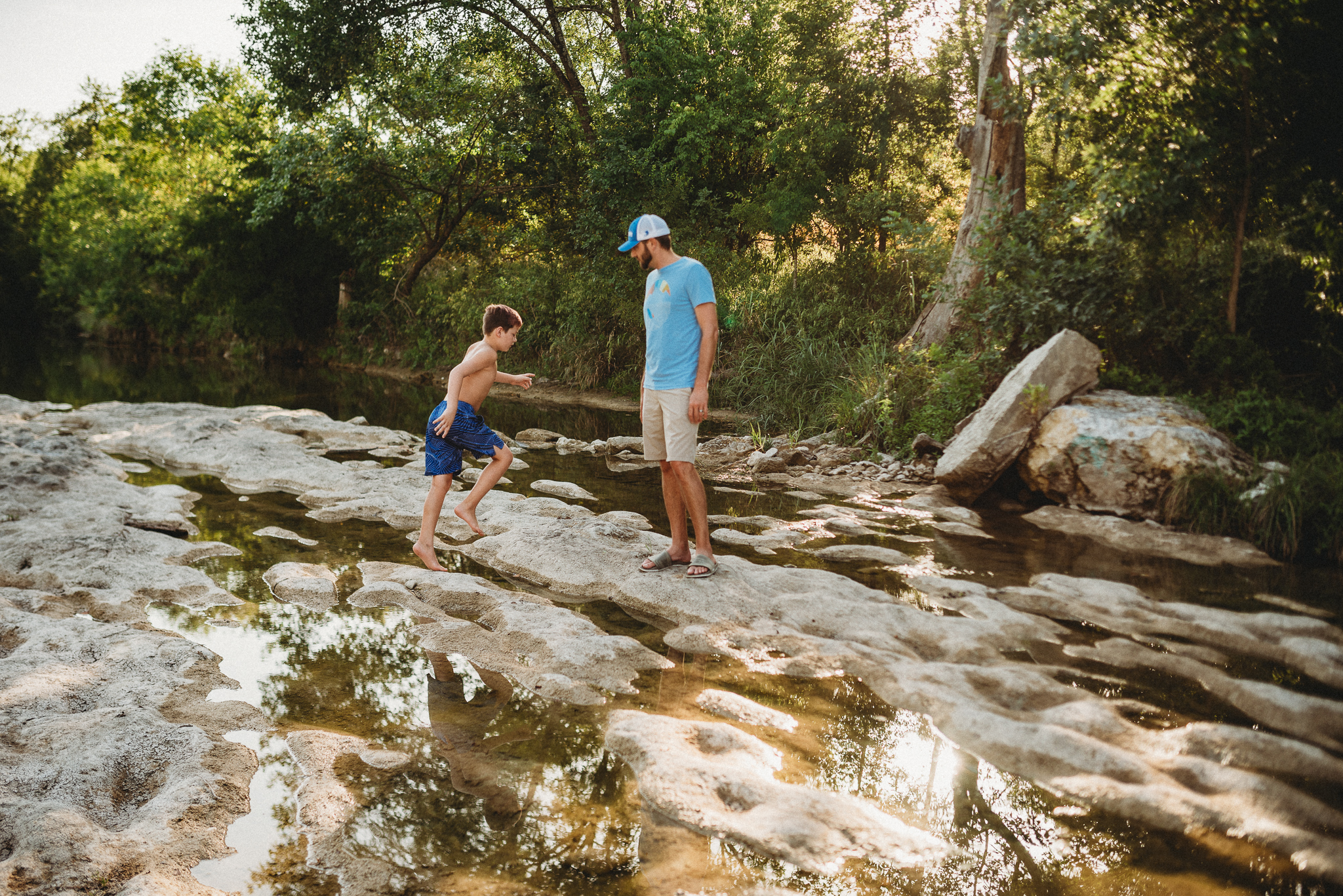 boy and dad exploring creek bed.jpg