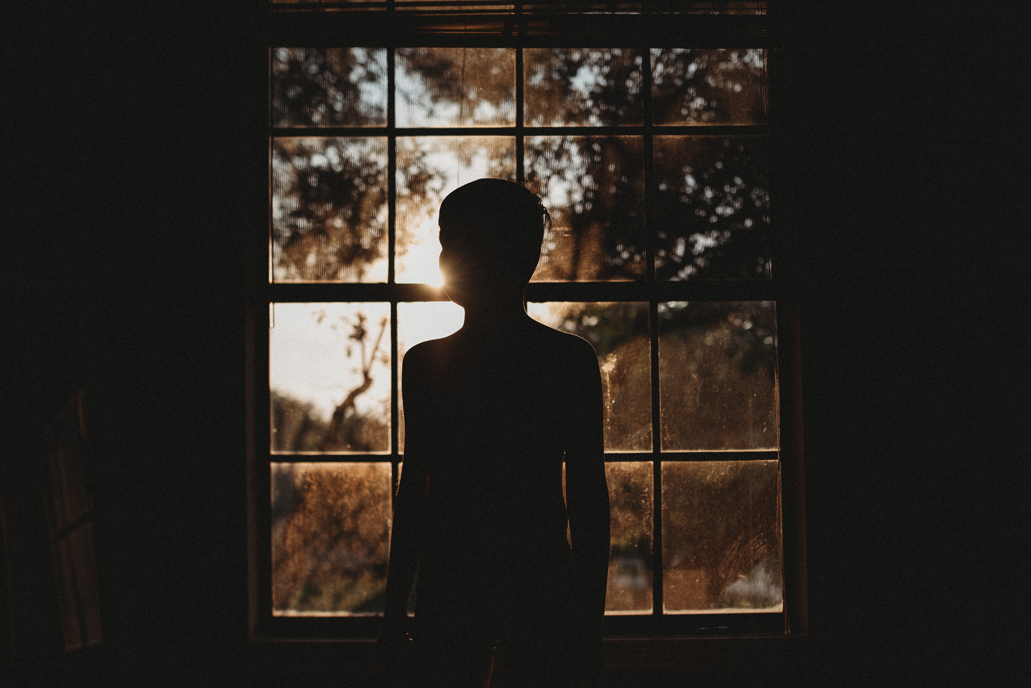 boy silhouette in window.jpg