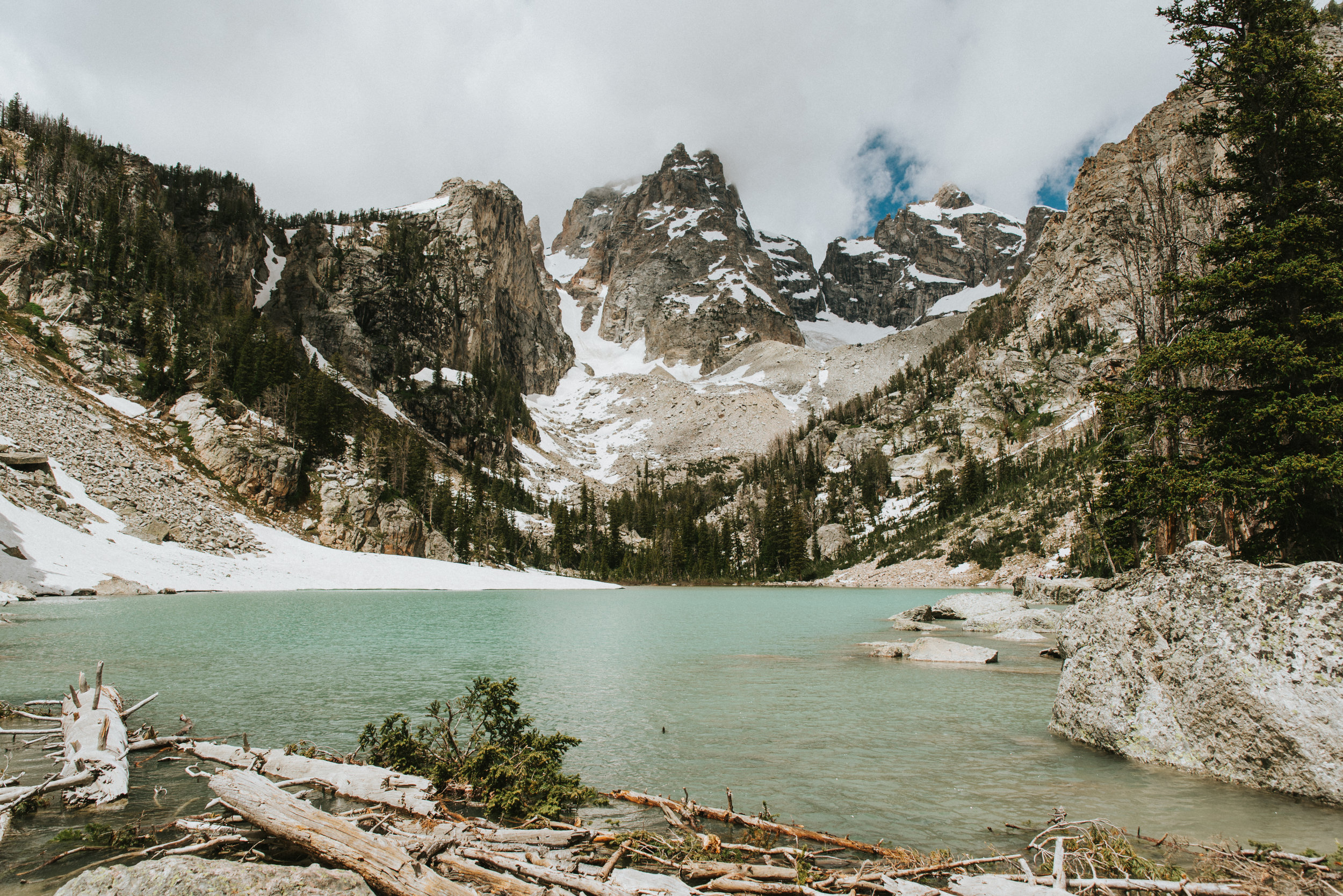 """This is a lake in Grand Teton National Park that I stumbled across on Google images and HAD to find for myself! It's not found on """"best hikes in the Tetons"""" lists and the trail is no longer maintained by the park. But it stands as one of my most favorite hikes I've ever done, and it was all the more satisfying because I had to work to find it myself. (And therefore, was a lot less crowded!)"""