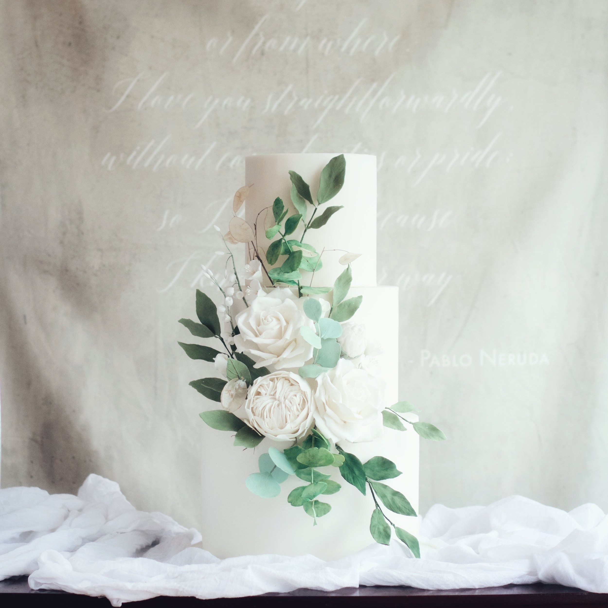GREENERY  Main focus on trailing green foliage and flowers in neutral tones.