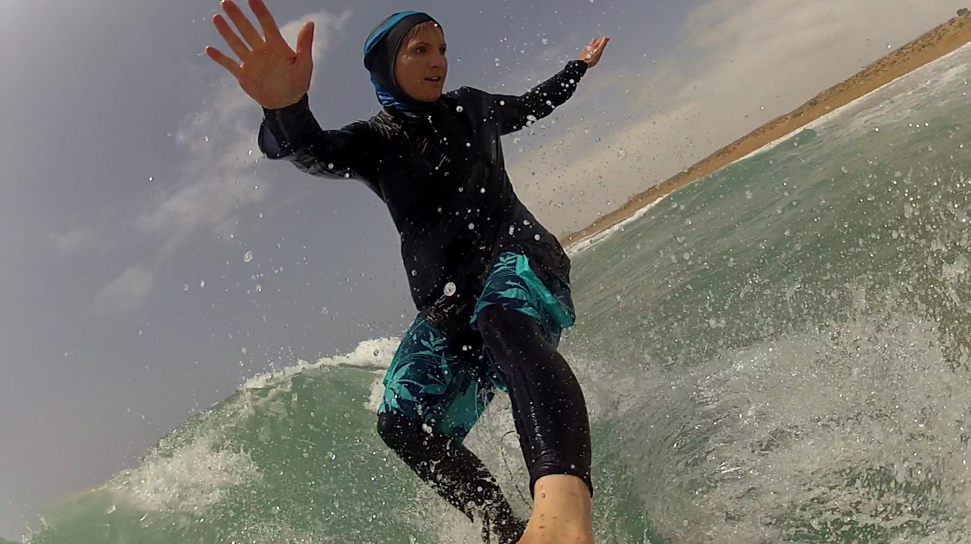 Easkey Britton surfing in a hijab, in Iran, fall 2014. Britton's initiative, Waves of Freedom, empowers young girls from local communities throughsurfing. Image: Marion Poizeau.