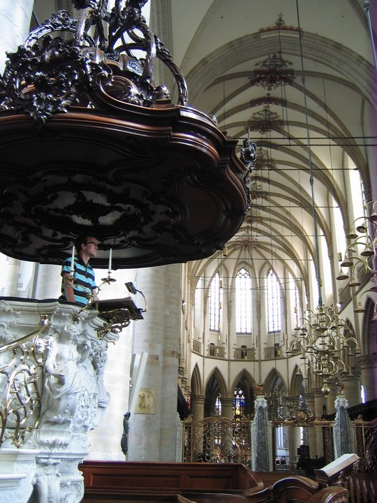 "Pastor Norm in the grand pulpit of the Grote Kerk of Dordrecht (the 'Great Church"" of Dordrecht, a city in the Netherlands where the Synod of Dort was held)"