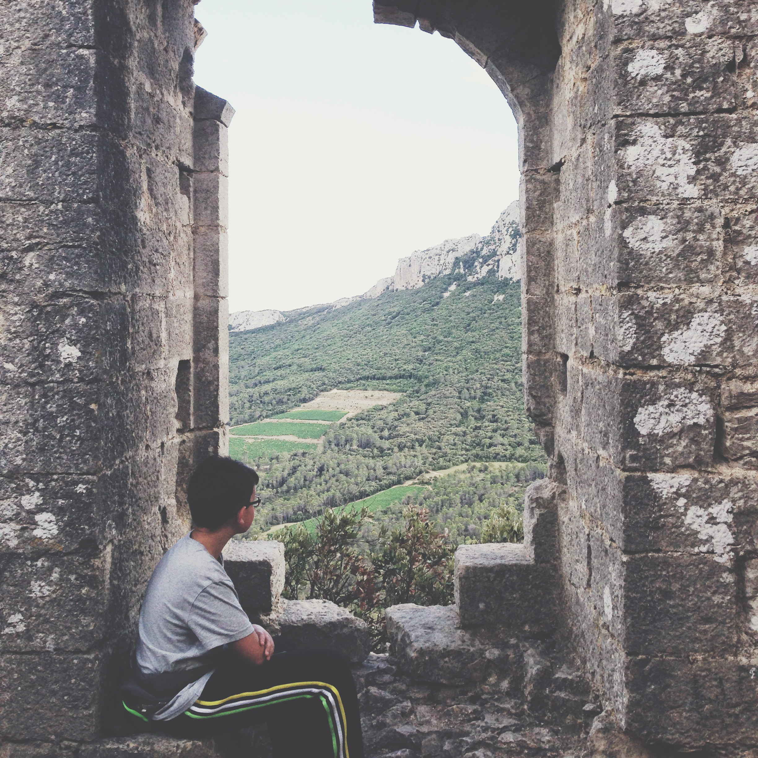 My 12 years old son sitting in the ruins of Castle of Viviourès (Hérault, France)
