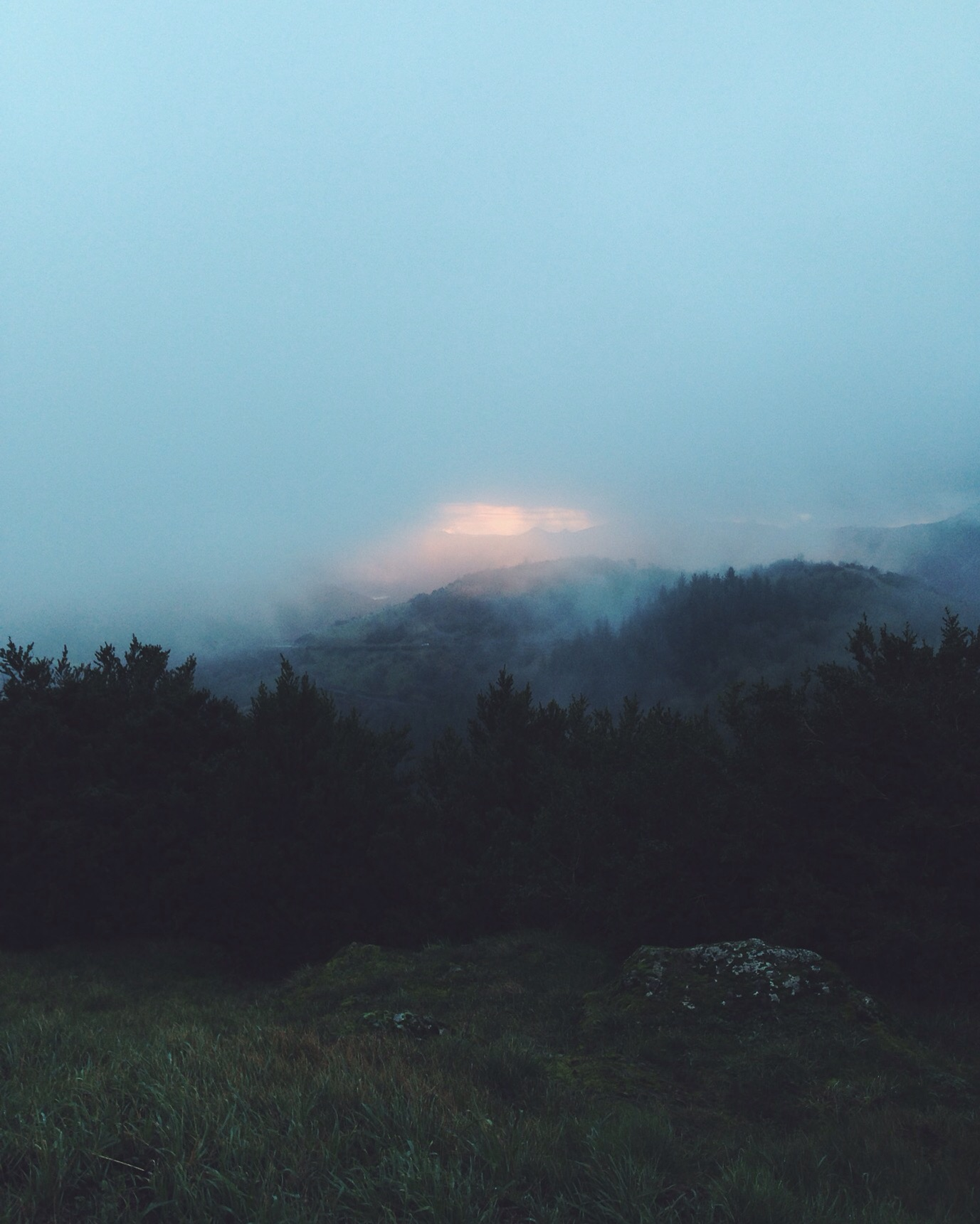 sunrise in foggy mountains