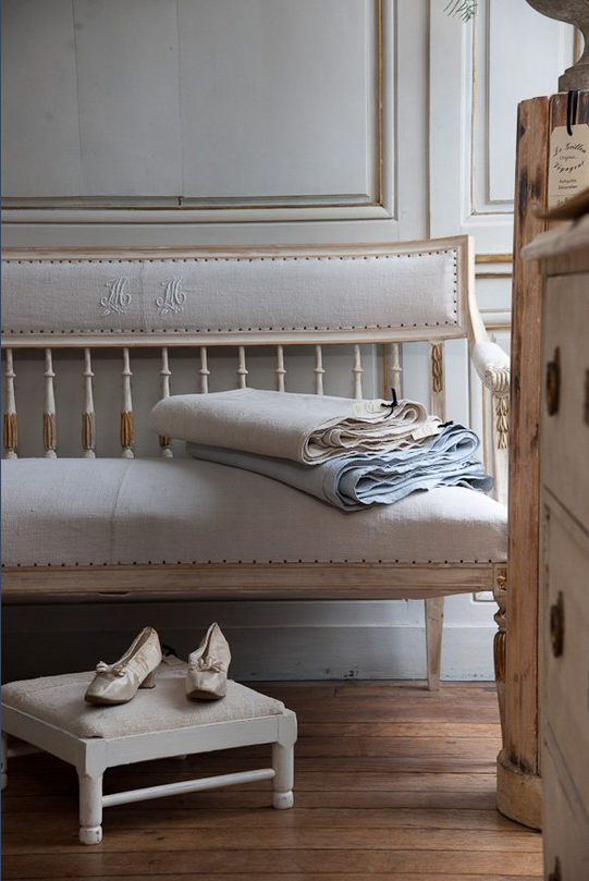 A beautiful setee upholstered using an antique French linen sheet!